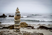 Stacked rocks on the Pacific ocean beach near Monterey, California.