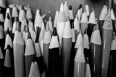 Black and white image of a close-up picture of colored pencils.