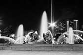 A couple at the Swann Memorial Fountain in Philadelphia, Pennsylvania in black and white.