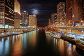 A Super Moon rising over the Michigan River in Chicago, Illinois