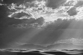 Image of sun rays shining down on the dunes from White Sands National Monument in Alamogordo, New Mexico