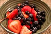 Bowl of strawberries, blueberries, and raspberries.