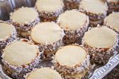 Alfajores cookies sandwiching dulce de leche rolled in shredded coconut.