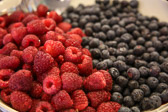 Raspberries and blueberries (fruit) in a bowl