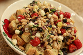 Fresh vegetable and bean salad over toasted croutons
