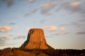 Long exposure of the sun rising on Devil's Tower National Monument near Hulett, Wyoming.