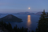 Blue Full Moon rising over the Blue Crater Lake at Crater Lake National Park in Oregon.