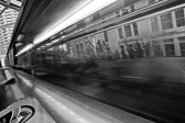 Black and white image of one of the Seattle monorail trains arriving at the Westlake Mall station in Washington.