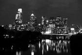 Black and white long-exposure image of the Philadelphia, Pennsylvania skyline from the Spring Garden Street Bridge.