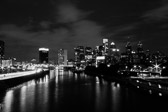Long exposure of the Philadelphia skyline during the blue hour from the South street bridge in black and white.