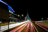 Long exposure of a night view in Boston, Massachusetts by the TD Garden and looking over the Leonard P. Zakim Bridge.
