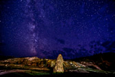 Long exposure with the milky way overlooking the Liberty Cap in Yellowstone National Park in Wyoming.