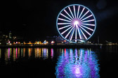 The Seattle Great Wheel in Washington reflecting off the water.