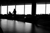 Silhouette of people waiting for a meeting to get started.