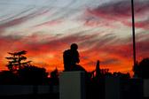 A pedestrian enjoying the sunset.