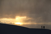 Standing and taking pictures of the setting sun at White Sands National Monument.