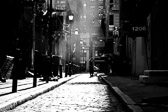 Worker cleaning out an alley in a Philadelphia, Pennsylvania in black and white.