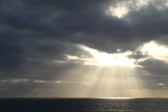 Light rays streaming through the clouds into the Pacific ocean off the coast of southern California.