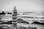 Black and white image of stacked rocks off the Pacific Ocean coast in Monterey, California..