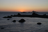 The sun setting into the Pacific ocean at Crescent City, California.